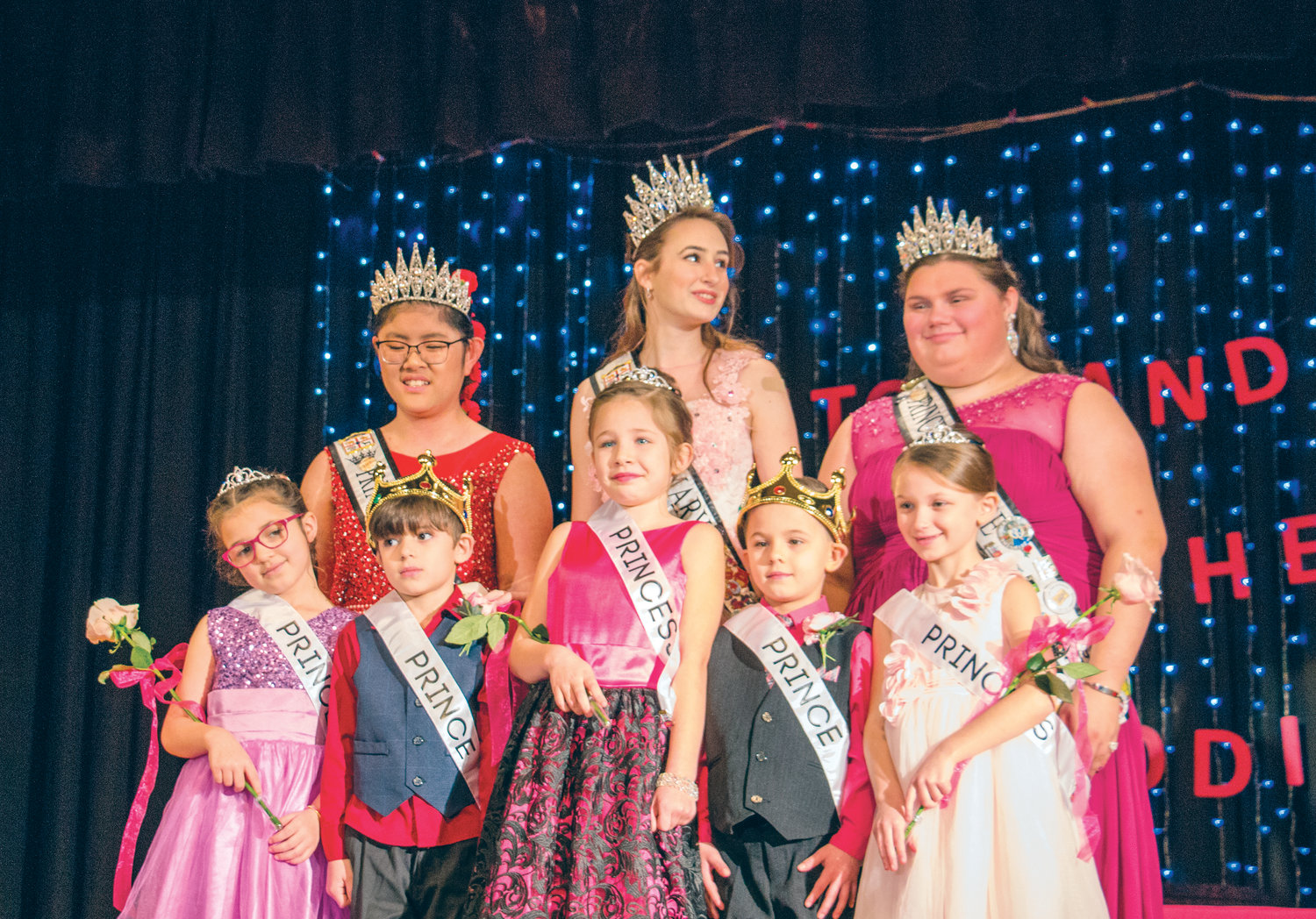 Outgoing 2019 Rhody Royalty, from left, Ellinne Thorton, Mary Neville and Kaylee Krajewski crowned the 2020 junior royalty from area elementary schools.