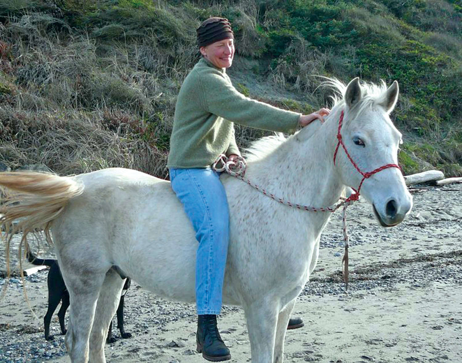 "Port Townsend author Christine Hemp rides Buddy, the ""Little White Horse"" who features in her memoir, ""Wild Ride Home."""