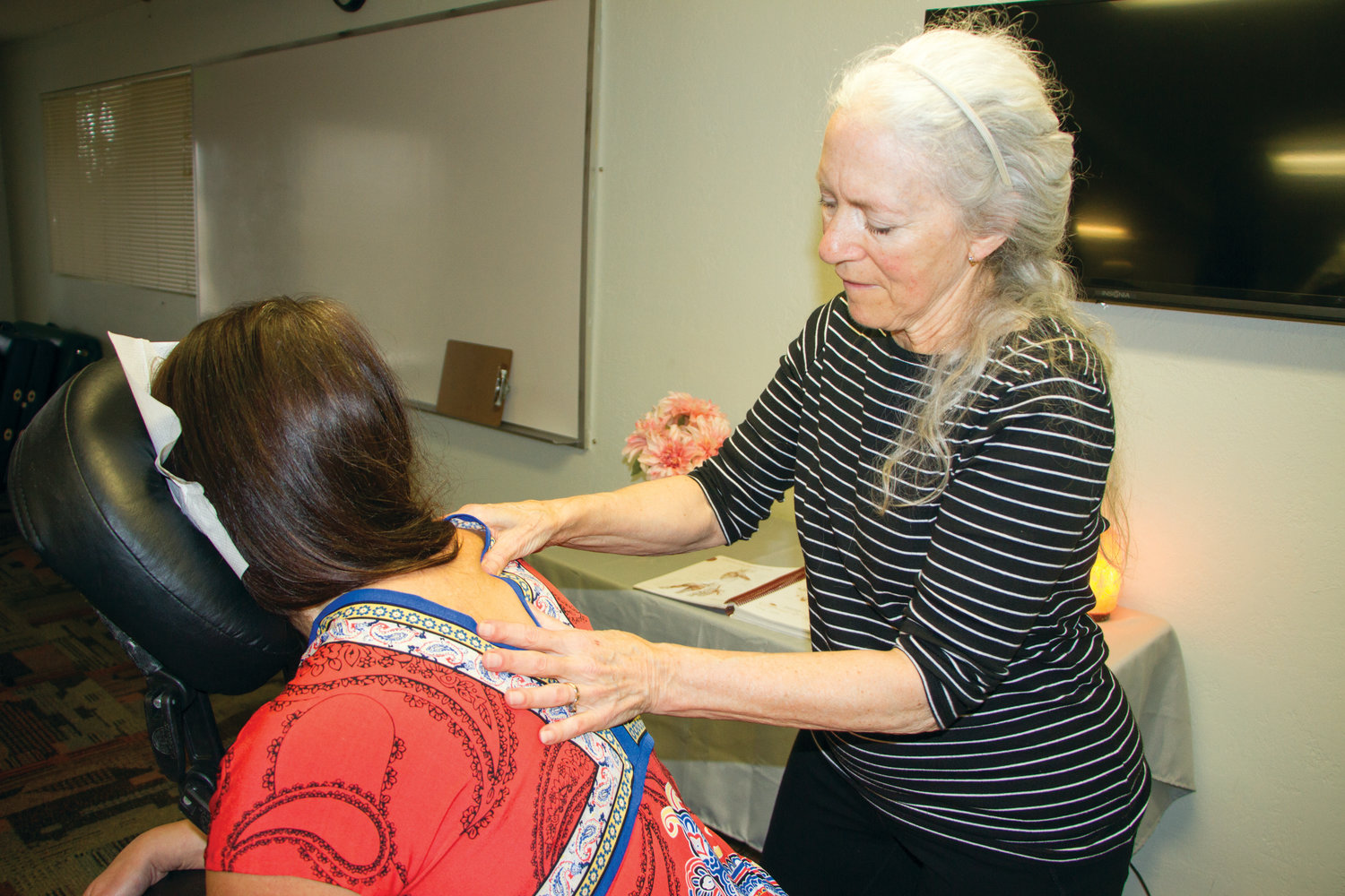 Port Townsend School of Massage student Leslie Tapper receives a demonstration massage from instructor Johanna Perkins.
