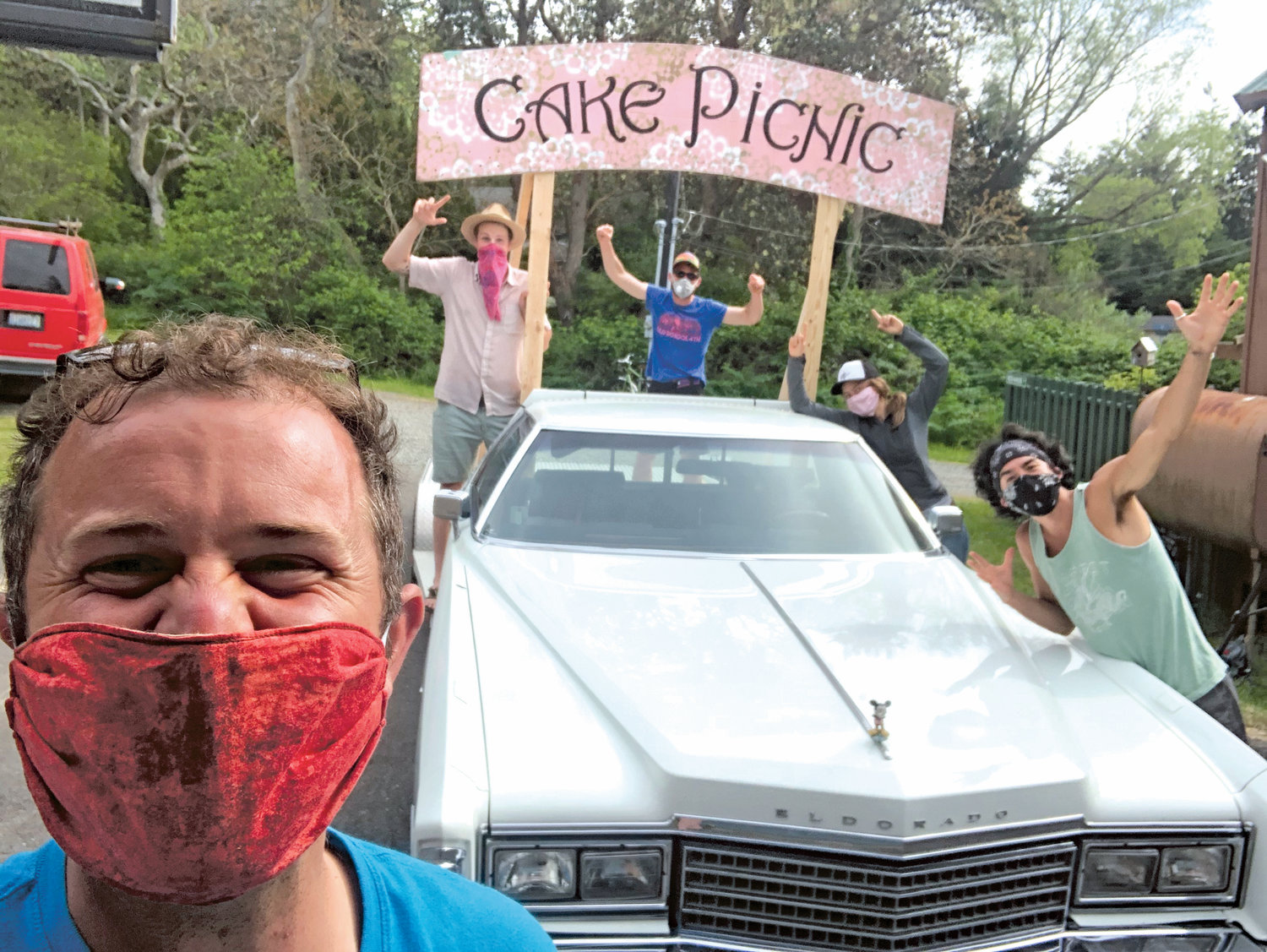 Danny Milholland and his Cake Picnic team plan a caravan through town May 16, when the annual Rhododendron Festival Grand Parade and Cake Picnic would have happened, had it not been canceled due to the coronavirus. Instead of gathering, community members can bake their own cakes, dress up and dance in their front yards as the picnic caravan drives by.