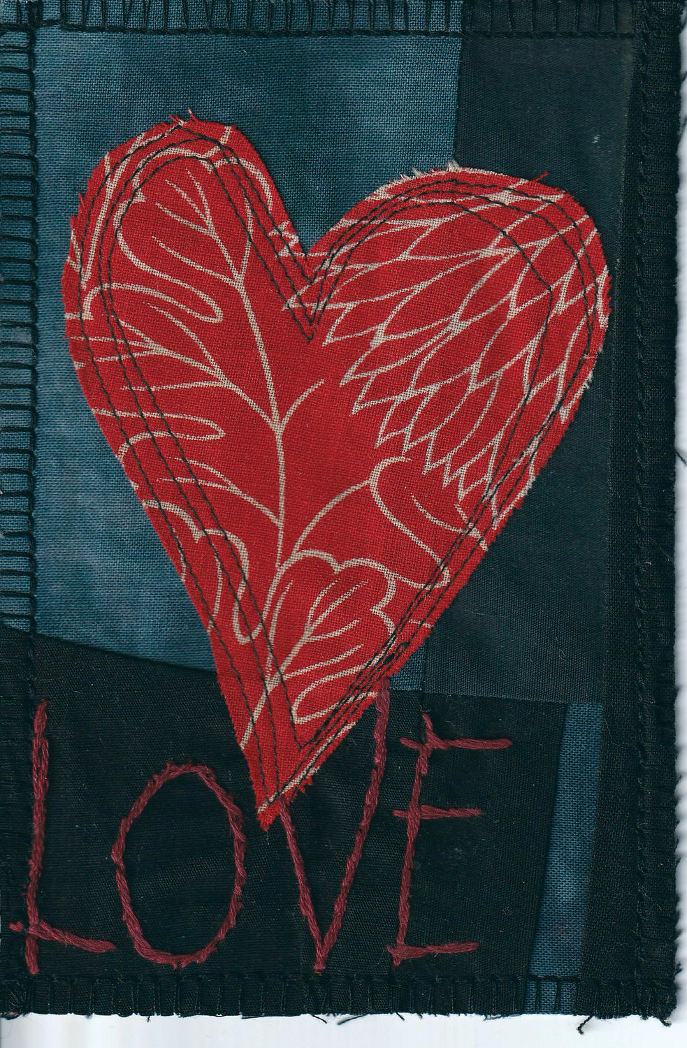 "Barbara Houshmand's textile postcard expresses a simple sentiment of ""LOVE."""