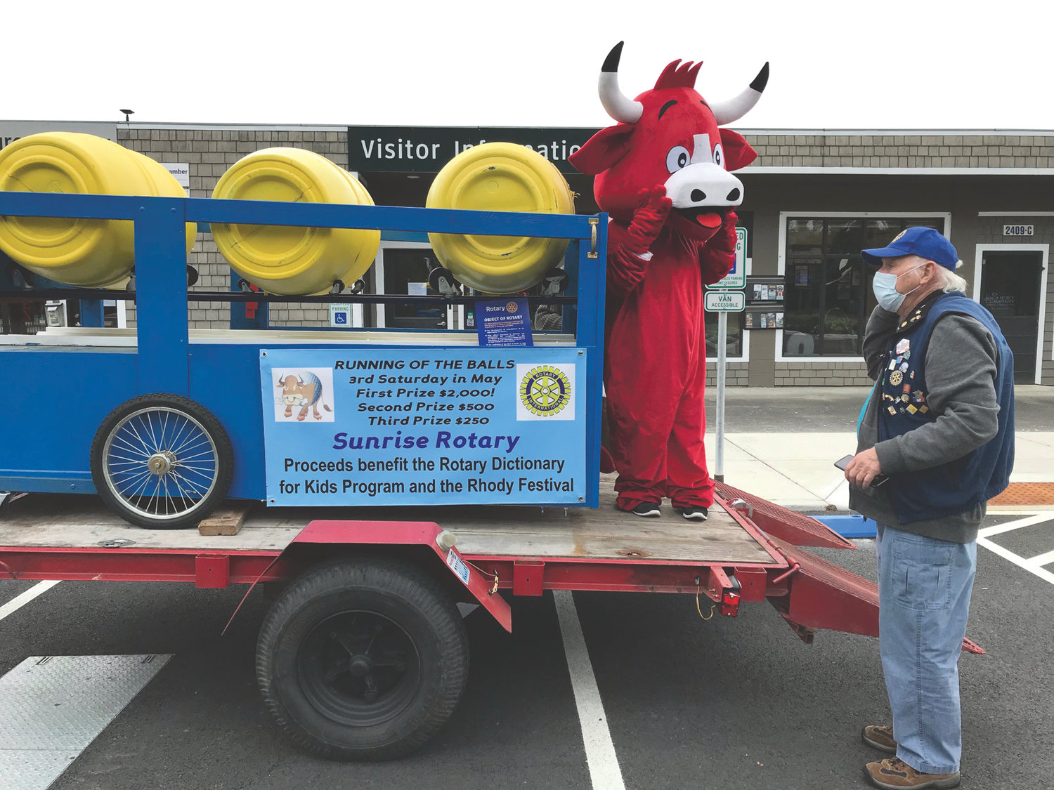 "Port Townsend Sunrise Rotarians maintained safe distancing and wore masks as they were joined by ""The Bull"" in drawing ticket stubs from barrels for this year's simulated ""Running of the Balls"" at the Visitors' Center Plaza."