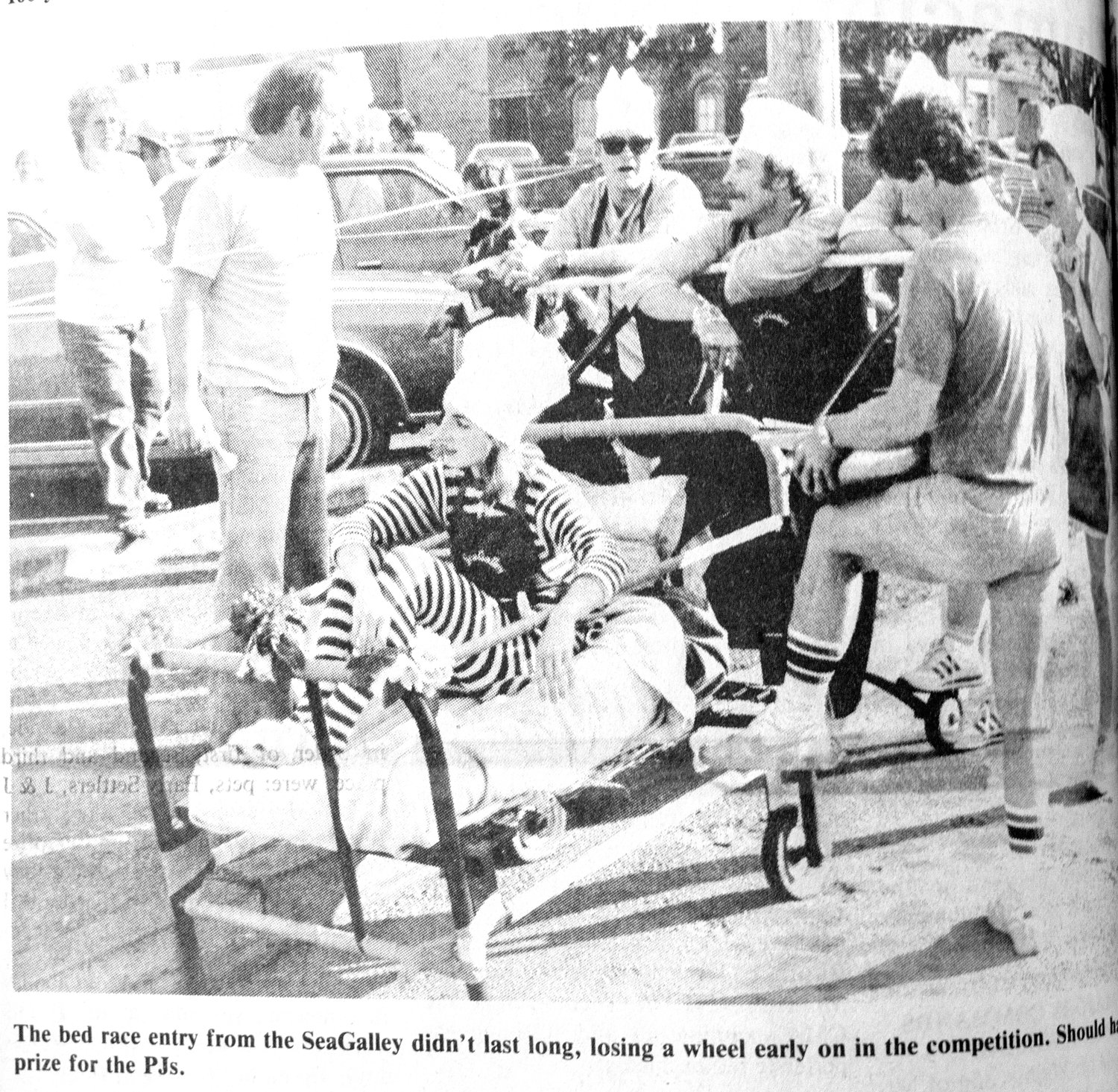 One participant in the 1985 bed race competition. Original Leader caption: The bed race entry from the SeaGalley didn't last long, losing a wheel early in the competition.