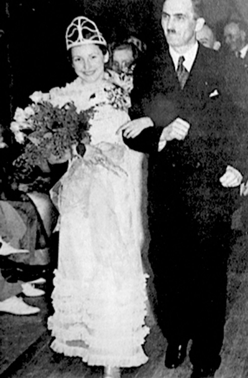 The first Rhododendron Festival queen, Myrtle Olsen accompanied by Washington Governor Clarence Martin at the 1936 festival.
