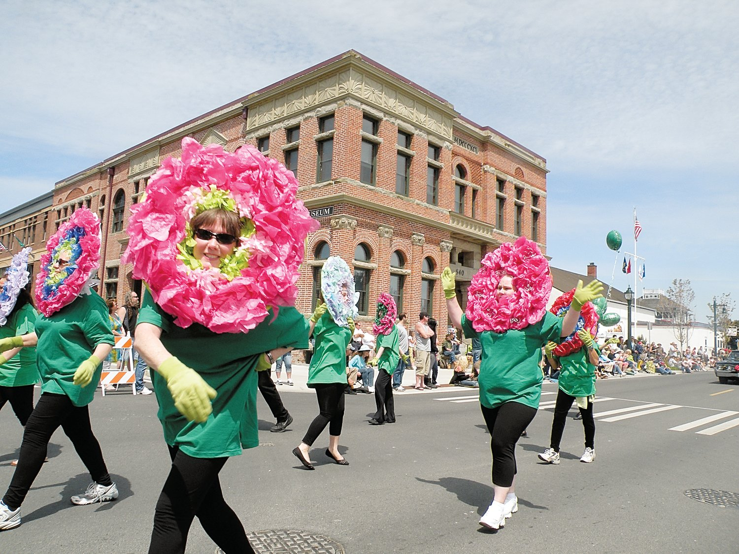"""Flowers"" dance down the parade route in 2012."