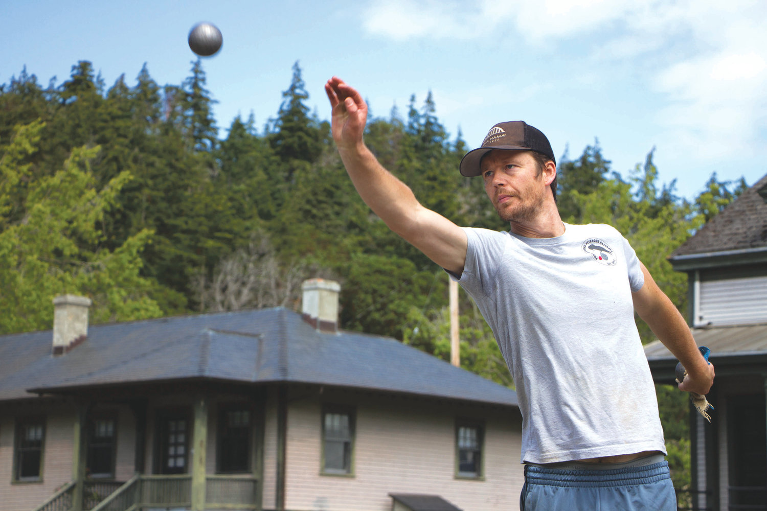 Silas Holm of Port Townsend launches his boule at the Port Townsend Pétanque Alliance's home court at Fort Worden State Park, aiming to get it as close to the target ball as possible.