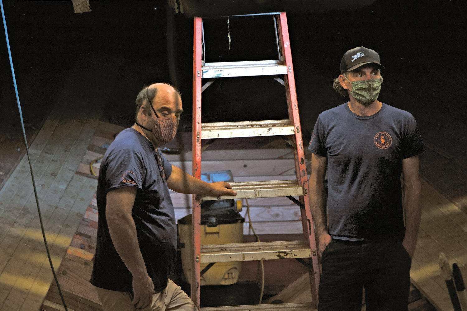 Tim Lee and Pete Rust survey the work below deck aboard the Western Flyer at the Port Townsend Shipwrights Co-Op.