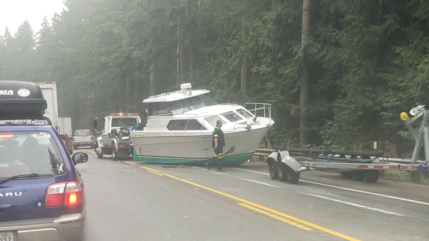 A yacht blocks the eastbound lane of Highway 104 west of the Hood Canal Bridge Tuesday.