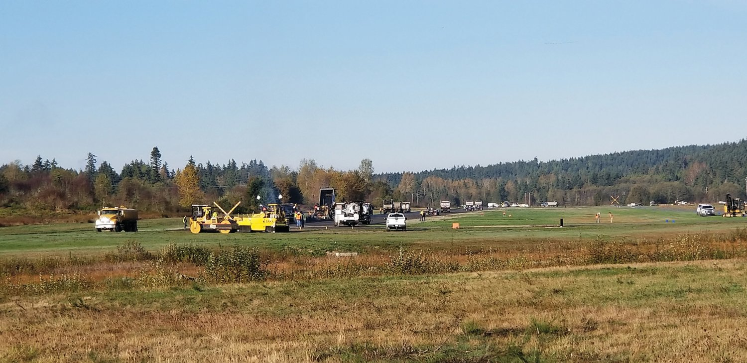 Construction crews work to fix the Jefferson County International Airport runway in October after surface defects were detected, bringing the runway out of Federal Aviation Administration specifications.