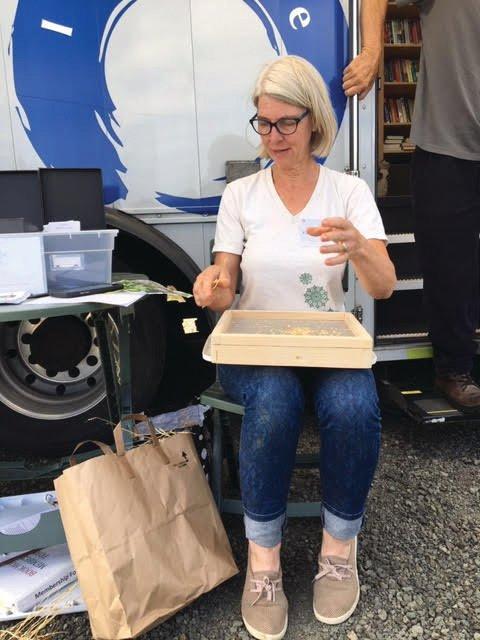 Karen Seabrook, Master Gardener Seed Library manager, volunteers at the pre-COVID library Bookmobile. Contactless pick-up of seed packets will be available at Bookmobile stops this spring.