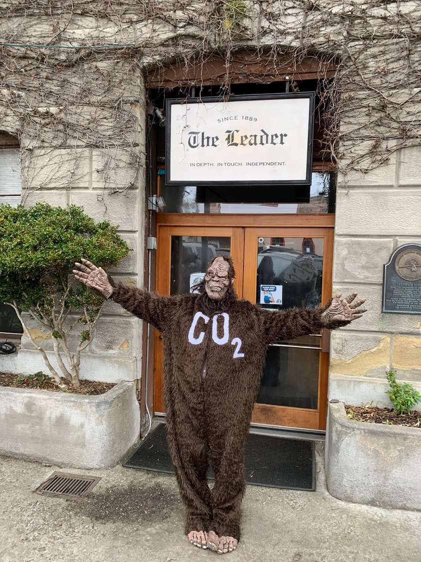Bigfoot (Polly Lyle) poses for a photo in front of The Leader's offices.