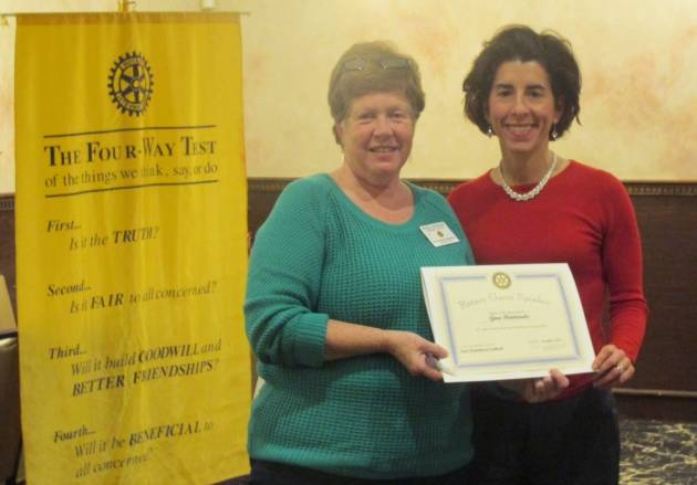 Treasurer Raimondo is presented a certificate of appreciation from East Providence Rotary Club President Patricia Bettencour
