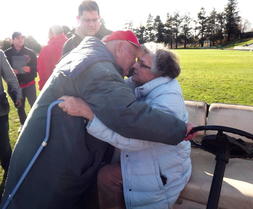 As the sun shone brightly down on Pierce Stadium, Bill Stringfellow whispers I love you, to wife Sheila.  Pierce Stadium honored them Thanksgiving Day 2014