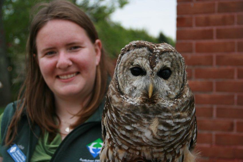 Audubon Educator Sharon Riley introduces a Barred Owl during an Audubon family program.