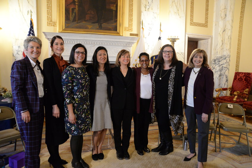 """Sen. Donna M. Nesselbush, far left, and Rep. Susan R. Donovan, far right, welcome the """"Doctors of Distinction"""" at the 2020 International Women's Day celebration held in the State Room of the State House."""