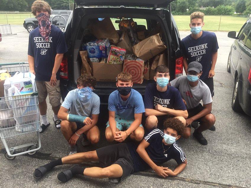The Seekonk High School Boys' Soccer Team ran a successful food drive for Doorways