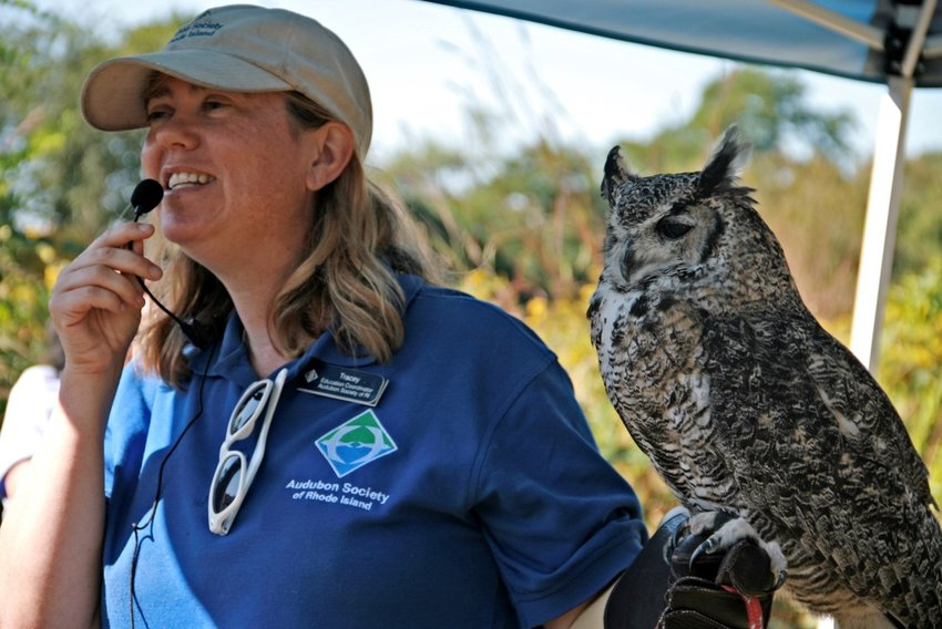 Audubon Educator Tracey Hall introduces a Great Horned Owl to visitors at the Audubon Nature Center and Aquarium.