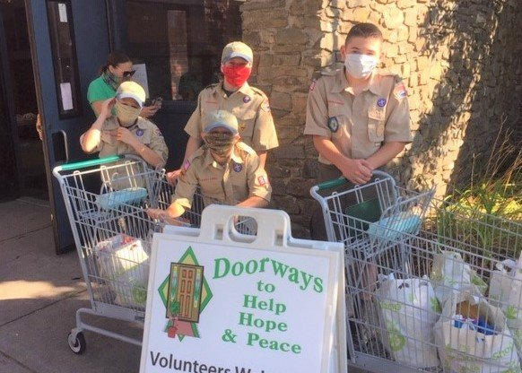 Scouts from BSA Troops 1 & 9 continue to assist with curbside distribution at Doorways
