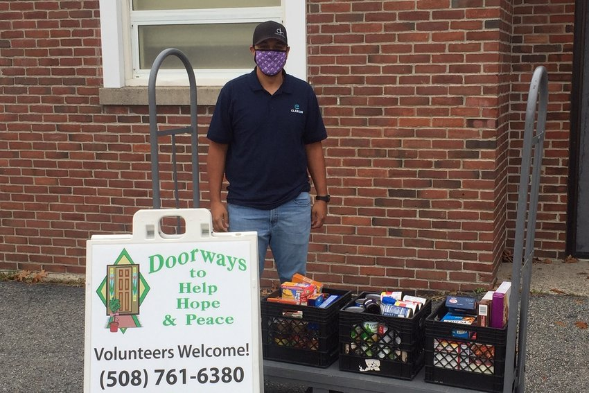 Esteban Castaneda, Guest Services Manager at the Clarion Inn in Seekonk, delivered several baskets of food to Doorways.