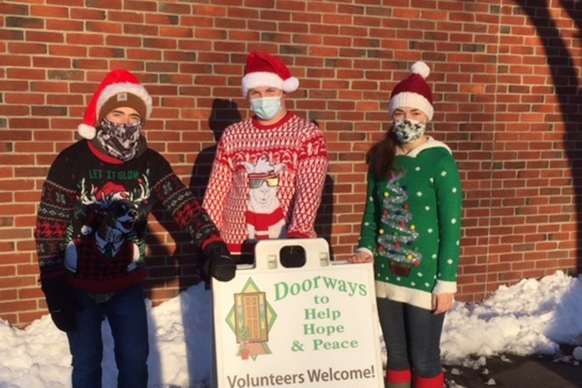"Evan Fasteson, Timothy Breen, and Emily Fasteson have worked every curbside food distribution for Doorways for the past eight months, with great energy and good humor. Doorways is pleased to name them ""Volunteers of the Year"" for the year 2020."