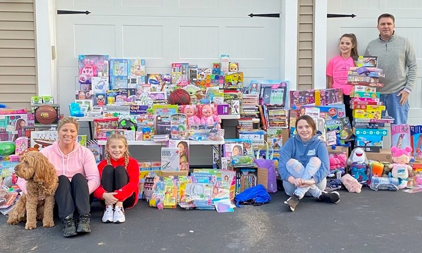 The McGovern family collected hundreds of toys for distribution to needy families in Seekonk. (L to R: Jennifer, Marley, Kaylen, Kerrin and Brian McGovern.)