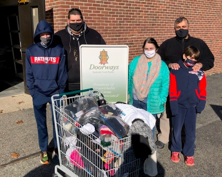 Members of Faith Christian Center delivered a gift of winter warmth to the clients of Doorways Food Pantry.