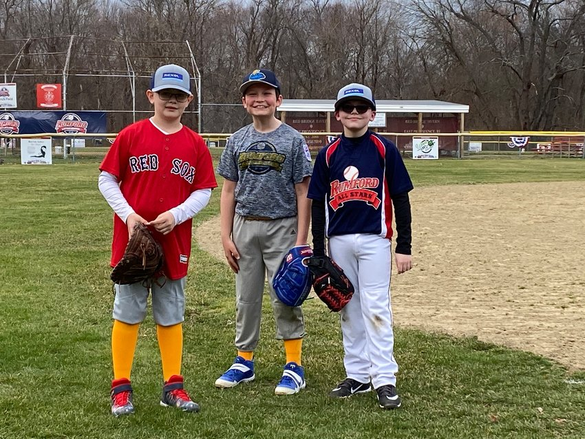 Myron Francis Elementary students, from left to right, Evan Provencher, Noah Lang, and Dean Masse, at practice in early April.