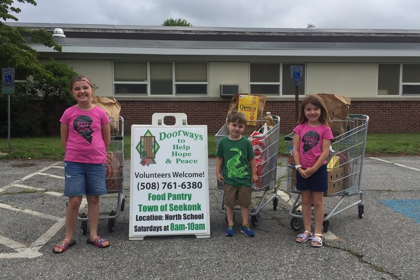 L to R: Zoe, Owen and Evie Graf dropping off food donations to Doorways. The donations were raised by the Aitken-Martin School musical production.