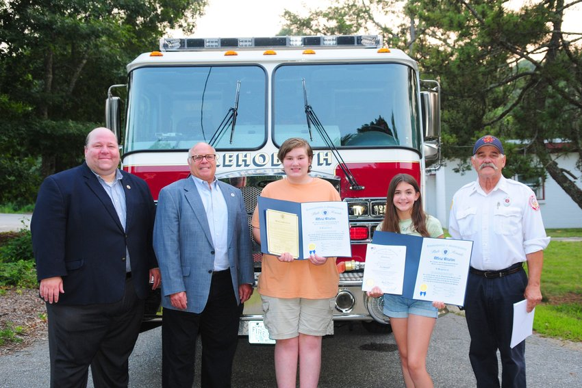 Senator Feeney, Representative Howitt, Ryan Bomes, Ava Randall and Lt. Randy Larrivee. On July 26 Ryan and Ava were honored at the Selectmen's meeting and by the State, for winning at the State and County level in the statewide fire safety poster contest. Their posters will be published in a calendar for 2022 that will be distributed throughout RI and MA.