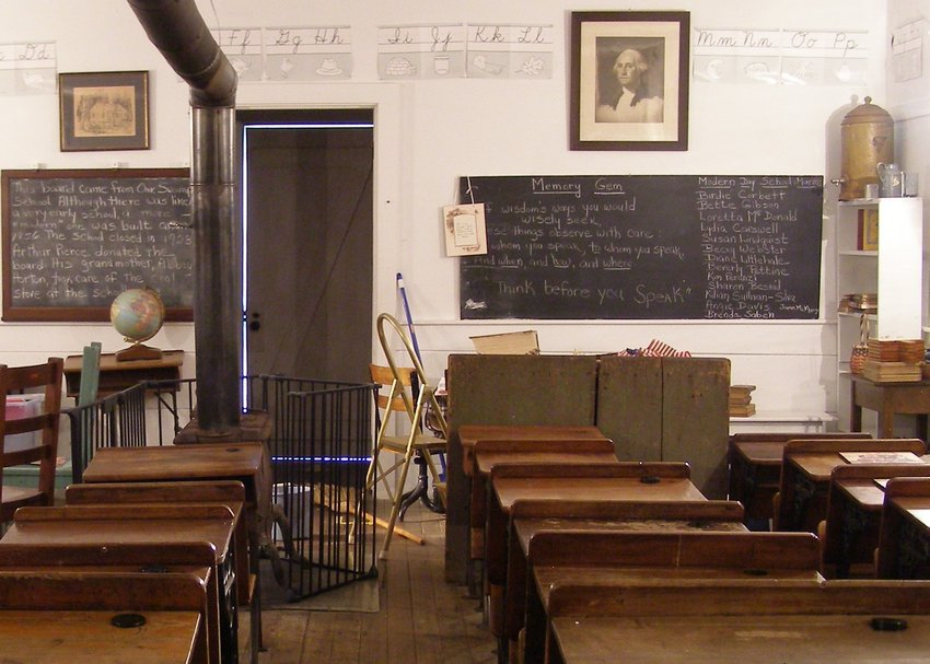 The Oak Swamp blackboard is on the left. The blackboard on the right is made from one plank of wood and was used at the Hornbine School in the 19th and 20th centuries.