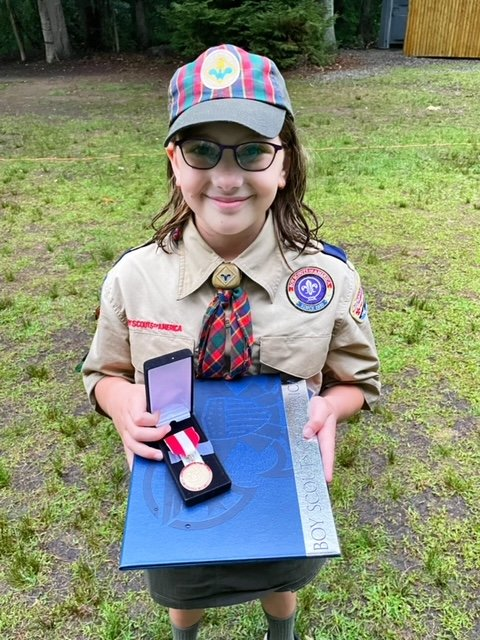 Lillith Moakler with lifesaving Medal and heroism certificate award
