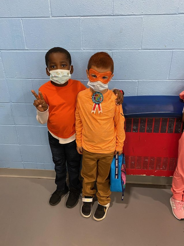 - Solomon and Logan are ready for class color day.