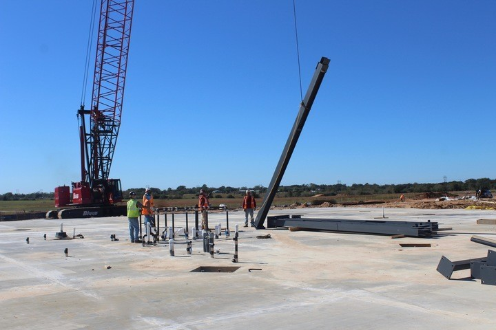 Red iron beams were placed into concrete slabs at the construction site for the new Sealy Elementary School on Oct. 26. These columns are the beginning of erecting the building's framework.