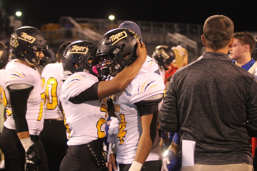 Senior Jose Rodriguez is embraced by a teammate after Sealy's season came to an end last week in a 35-14 loss against the Henderson Lions.