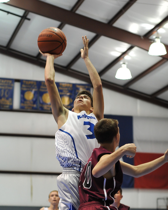 Brody Schiller scores a basket in his nine-point performance against Still Creek. The Knights won the game 62-41.