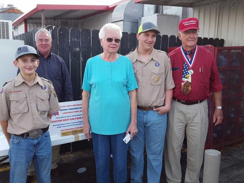 """Pictured are Troop 299 scout Colton Kasse, Neil Foster, Adeline Luedke, Troop 299 scout Ryan Johnson and H W """"Buddy"""" Koenig."""