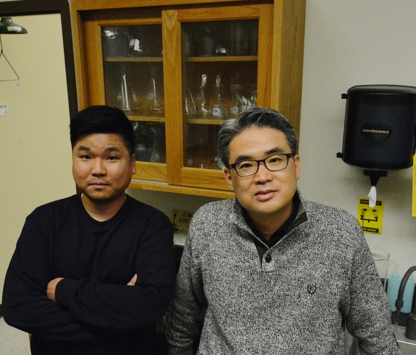 Dr. Hyun Min Jang, AgriLife Research environmental engineer (left), and Dr. Eunsung Kan, AgriLife Research chemical and environmental engineer, both in Stephenville, are working with biochar to find an efficient way to rid farms of animal waste via anaerobic digestion.