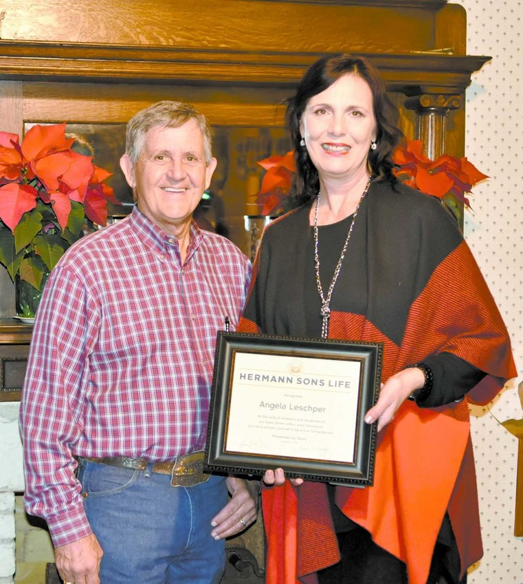 The Sealy Chapter of Hermann Sons Life Lodge presented Angela Leschper, right, of Sealy with the annual Humanitarian Award. Lodge President Johnny Griffin, left, made the presentation.