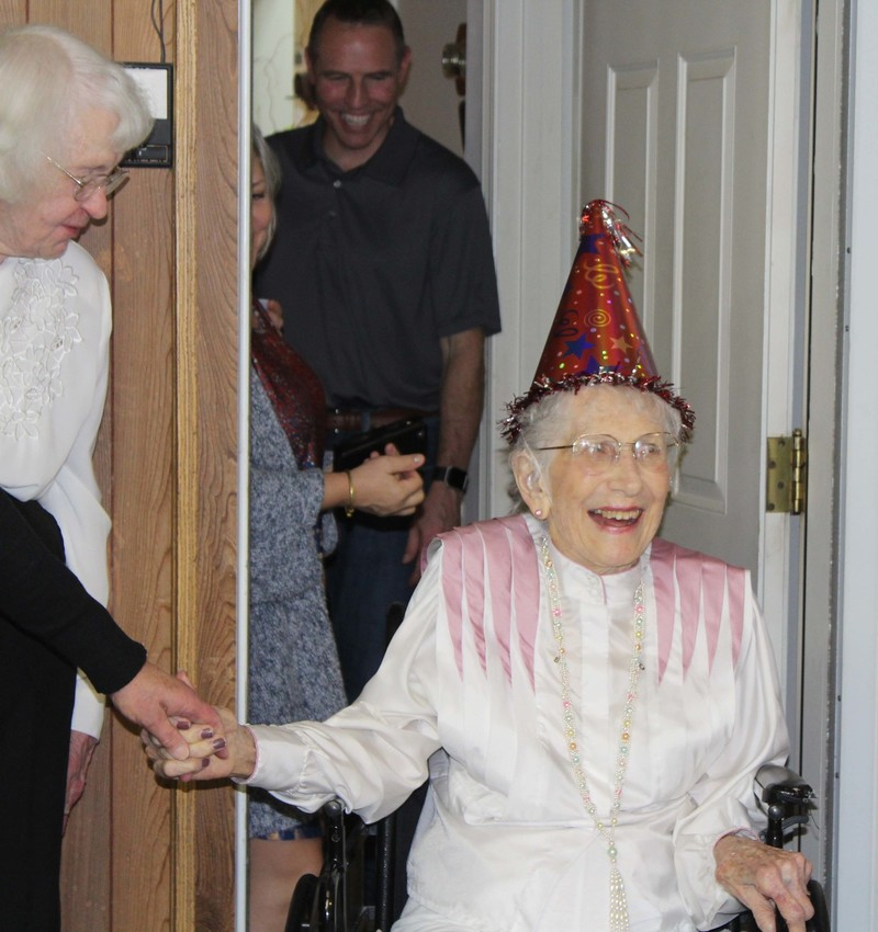 The birthday girl greeted dozens of guests at her home on Brazos Hill Lane.