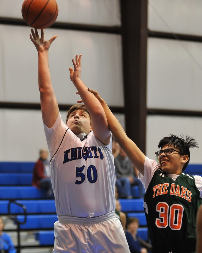 Junior Cameron Crawford was a key rebounder for the Knights in two of their most recent games nabbing eight against Oaks and seven against Covenant Prep. Courtesy photo.
