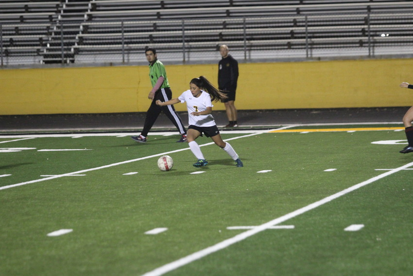 Vanessa Villagomez chases down the ball in the Lady Tigers match against Hargrave last week. It was the first official competition to be held on the new turf Mark A. Chapman Field.