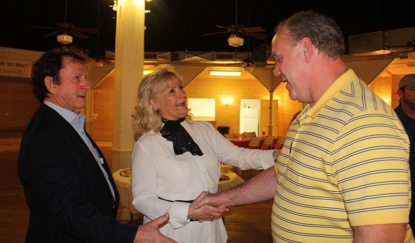 Sealy City Manager Lloyd Merrell and wife Marsha greet a resident during a reception Saturday night at Liedertafel Hall.