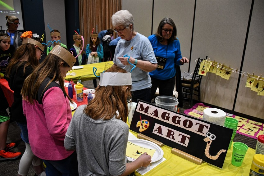Fourth-grade students got hands-on experience with insects at the recent Insect Expo in New Braunfels, including using them to create art.