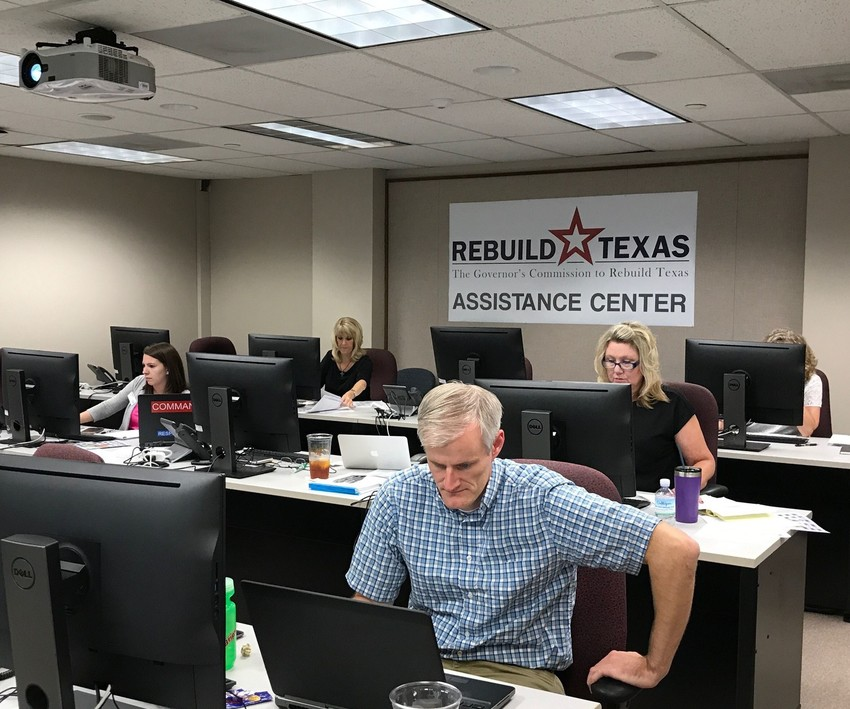 Courtesy Photo   Agency personnel coordinate activities at the Rebuild Texas Assistance Center in the Moore-Connally Building on the Texas A&M Campus.
