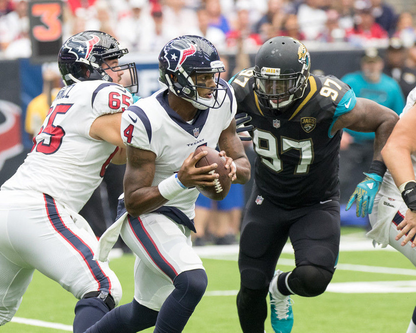 Houston Texans quarterback Deshaun Watson (4) scrambles on a play while Jacksonville Jaguars defensive tackle Malik Jackson (97) pursues during the second half of the NFL game between Houston and Jacksonville at NRG Stadium in Houston, Texas.