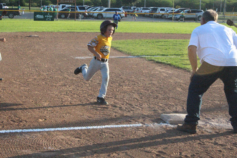 Sealy 7/8-year old All Star Reese Reichardt reaches third base after hitting a triple on Sunday at B&PW Park in a warm up game against Rice Little League.