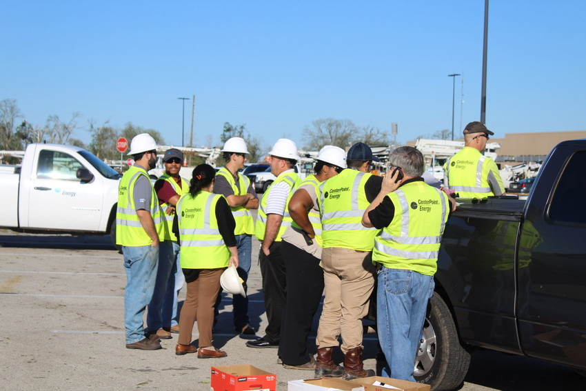 A large group of CenterPoint Energy employees await their assignments the morning after the Microburst that hit Sealy May 24.