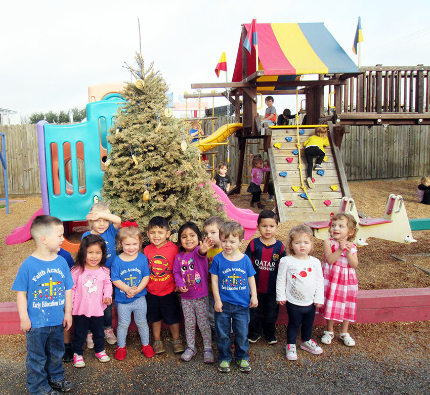 """January has gotten off to a great start. However, Mrs. Remmert's and Mrs.Carlin's Nursery students at Faith Academy were not quite ready to say goodbye to the Christmas season. So, they decided to continue on with the spirit of sharing. They made ornaments for the birds to eat and hung them on their old Christmas tree, just like in the story, """"The After Christmas Tree"""". They enjoyed watching as the birds came by to eat the treats. 2017 is going to be a great year of giving."""