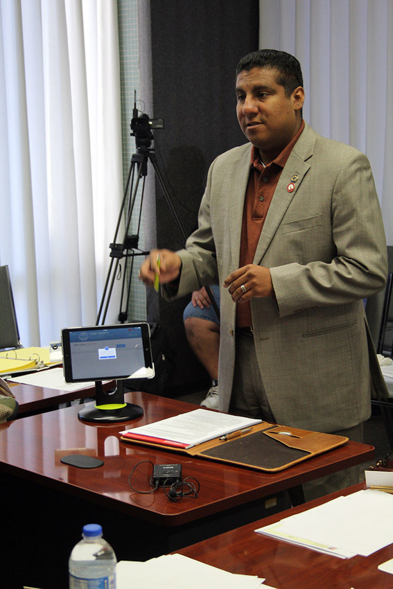 Former Austin County Tax Assessor-Collector and Election Official Marcus Peña showcases a new polling pad for the county purposed for the 2016 March primaries during a commissioners court meeting in February 2016.