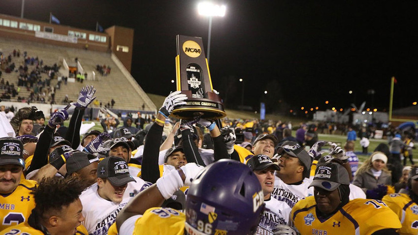 Mary Hardin-Baylor players lift the NCAA trophy following their 10-7 victory over Wisconsin Oshkosh in the Stagg Bowl for the Division III national championship Friday in Virginia.
